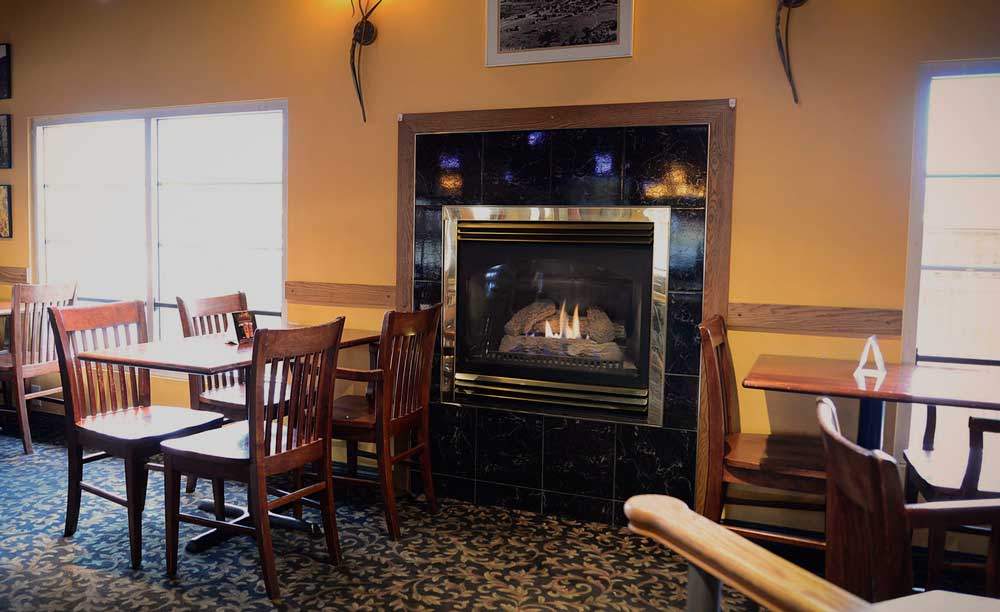 photo of tables near a romantic fireplace